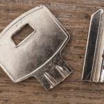 A broken key on wooden table