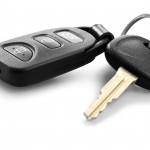 car key with remote control over white background